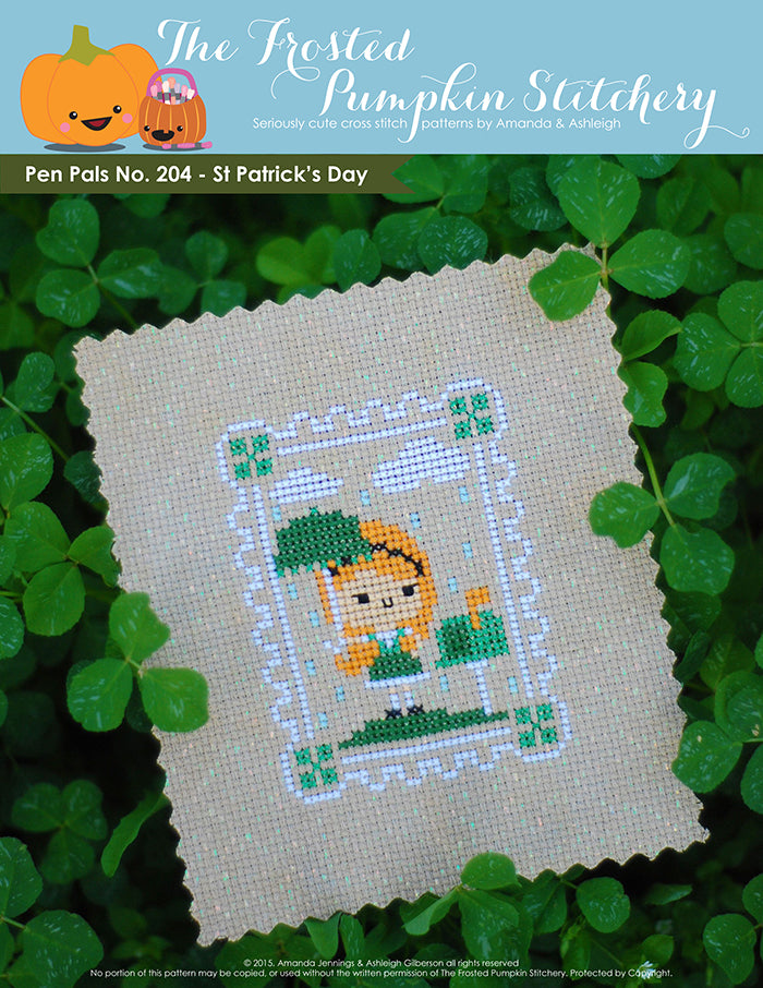 Pen Pals No 204 St Patrick's Day counted cross stitch pattern. A pale girl with red hair stands under a green umbrella next to a mailbox.