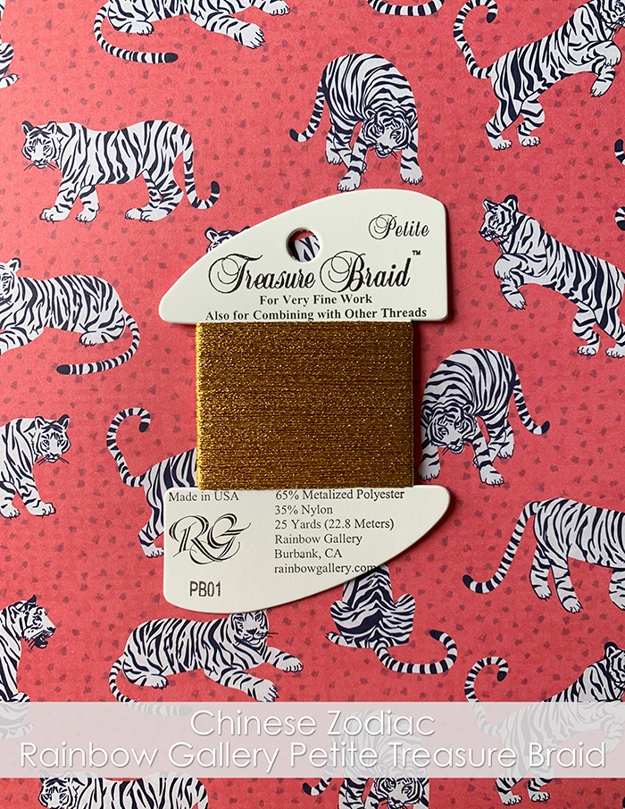 Rainbow Gallery Petite Treasure Braid. PB01 Gold. On a piece of tiger printed paper.