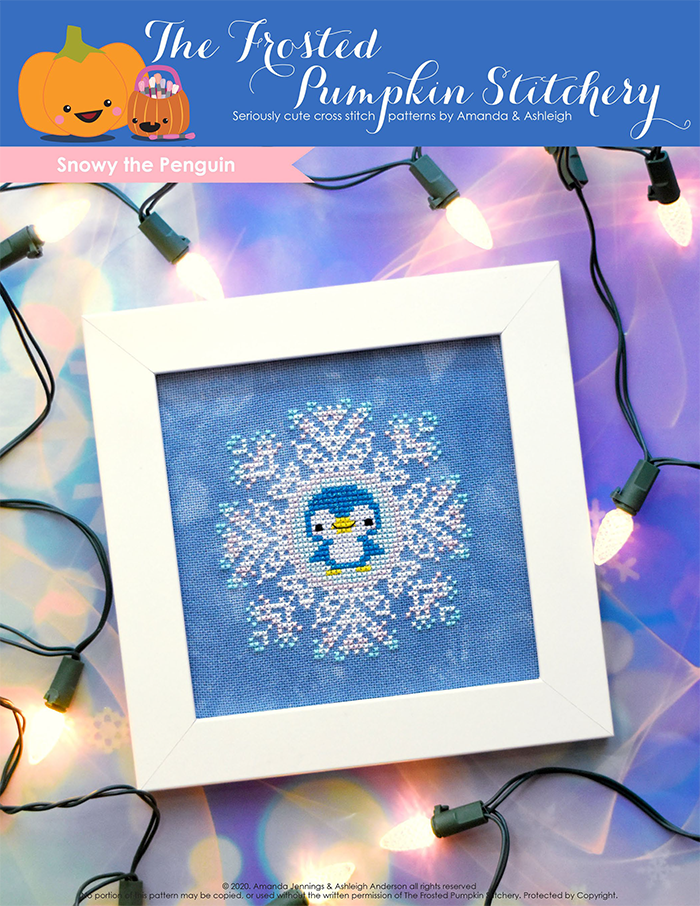 Image of Snowy the Penguin counted cross stitch pattern featuring a sparkly blue penguin in the center of a snowflake and framed in a simple white frame.