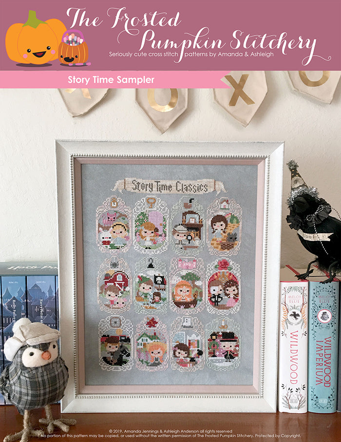 Storytime Sampler counted cross stitch pattern. Twelve characters from stories such as Alice in Wonderland, Phantom of the Opera, Anne of Green Gables and more. It's in a white frame on a bookshelf.