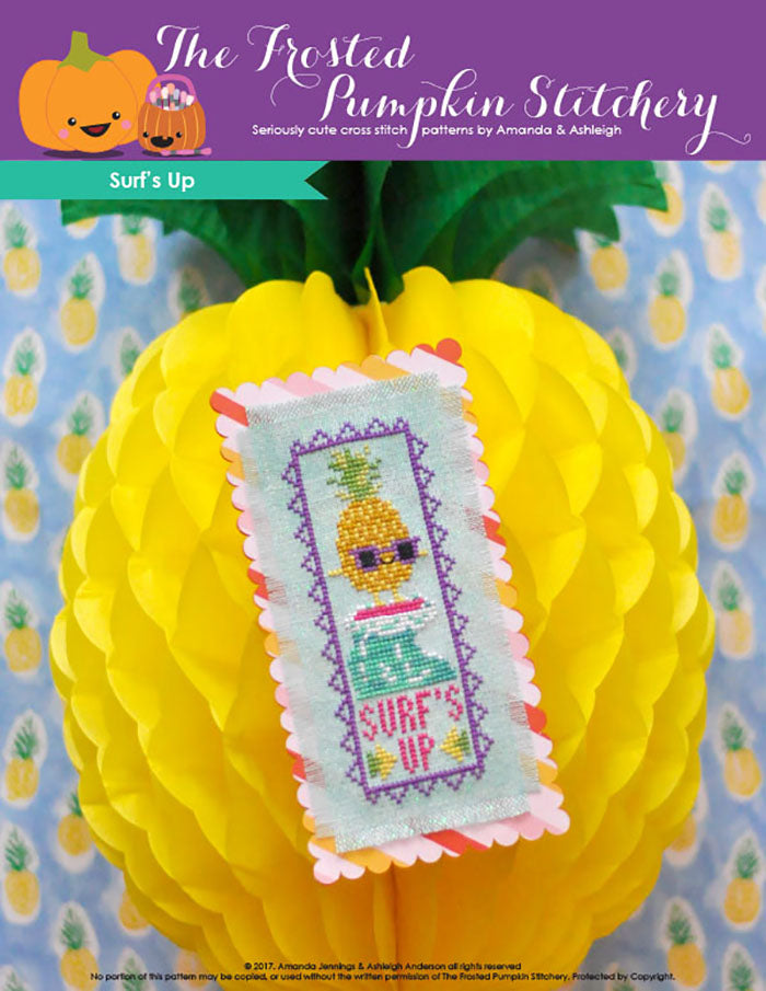 "Surf's Up counted cross stitch pattern. A surfing pineapple on a bookmark. Text reads ""Surf's Up""."