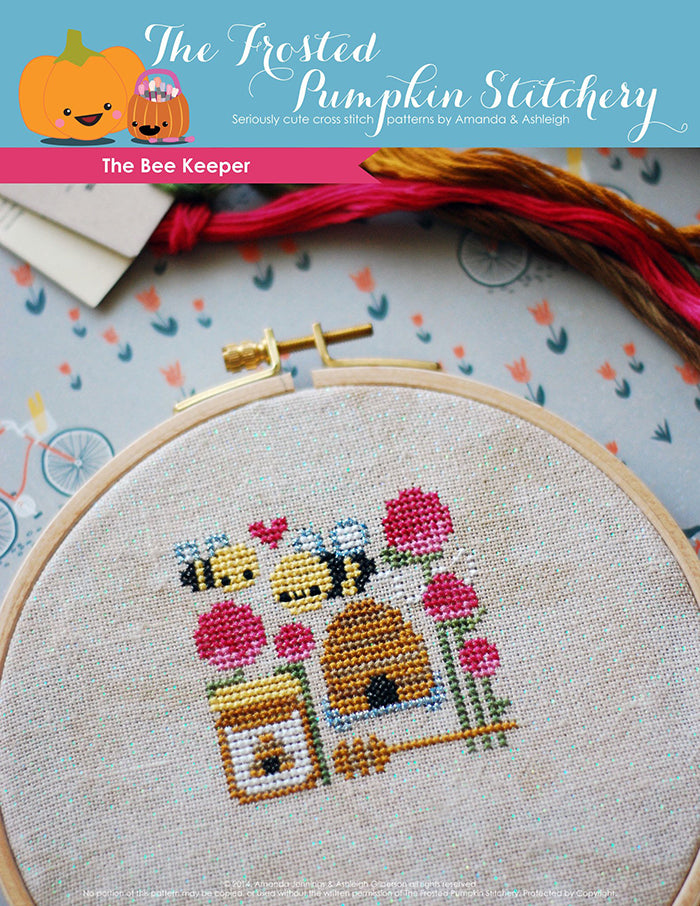 The Bee Keeper counted cross stitch pattern. Two bees with a hive, honey and thistles.