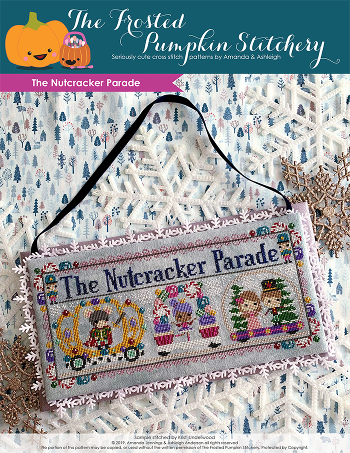 The Nutcracker Parade counted cross stitch pattern. The sugarplum fairy is in a candy decorated float, the rat king is in a crown decorated float to her left and Clara and the prince are in the float to the right.