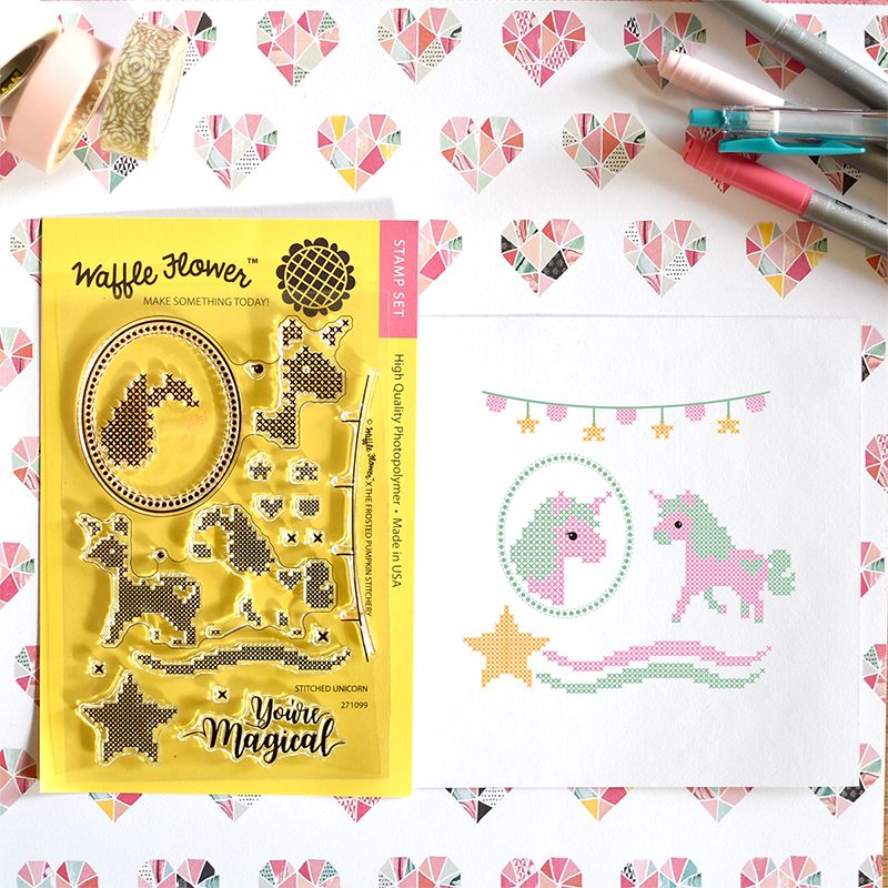 Waffle Flower Cross Stitch You're Magical Stamp Set. Stamped unicorns on cardstock with pens and paper.