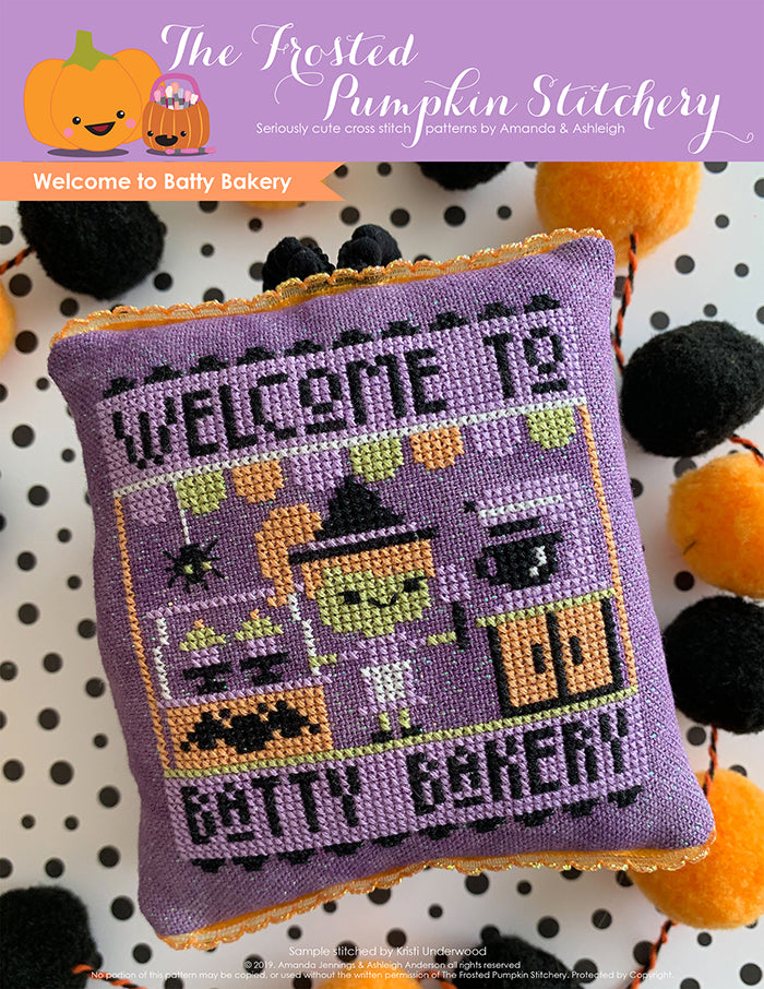 Welcome to Batty Bakery Halloween counted cross stitch pattern. A green skinned purple haired witch stands in front of a mixer holding a spatula.