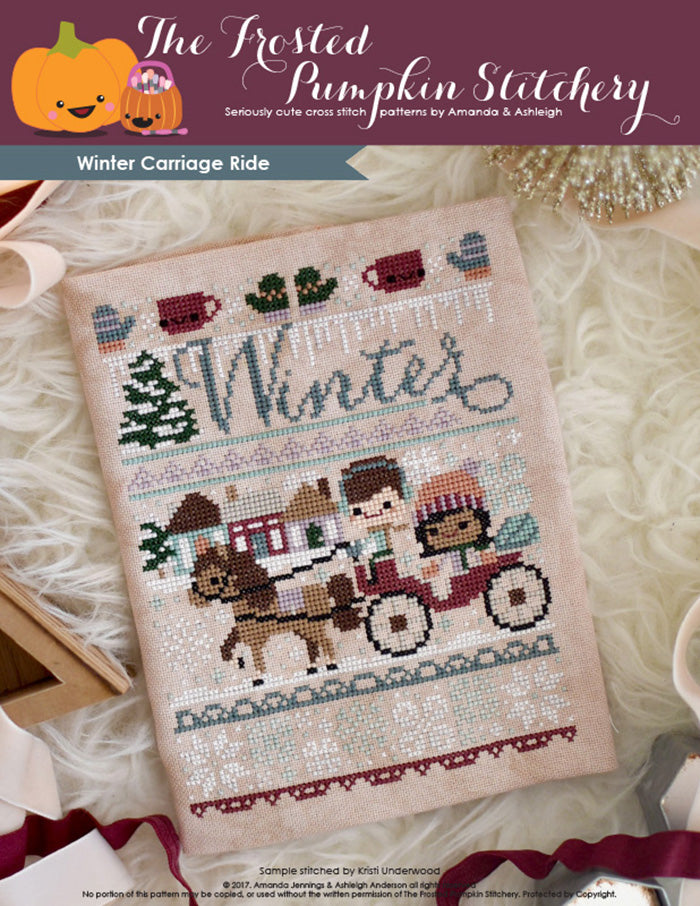 Winter Carriage Ride counted cross stitch pattern. A horse drawn carriage with a man with fair skin and medium brown hair and a woman with light brown skin and dark hair. She's wearing a peach colored hat, he's wearing ear muffs.