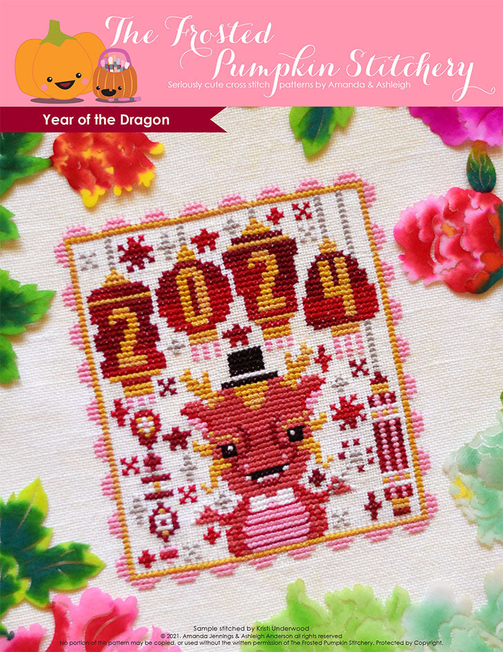 Year of the Dragon counted cross stitch pattern. A dragon wearing a top hat and holding a sparkler with lanterns that say 2024.