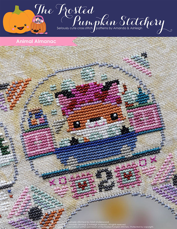 Animal Almanac Cross Stitch Pattern Cover. Image of a fox in the bath tub surrounded by bubbles, stamps and a number 2.