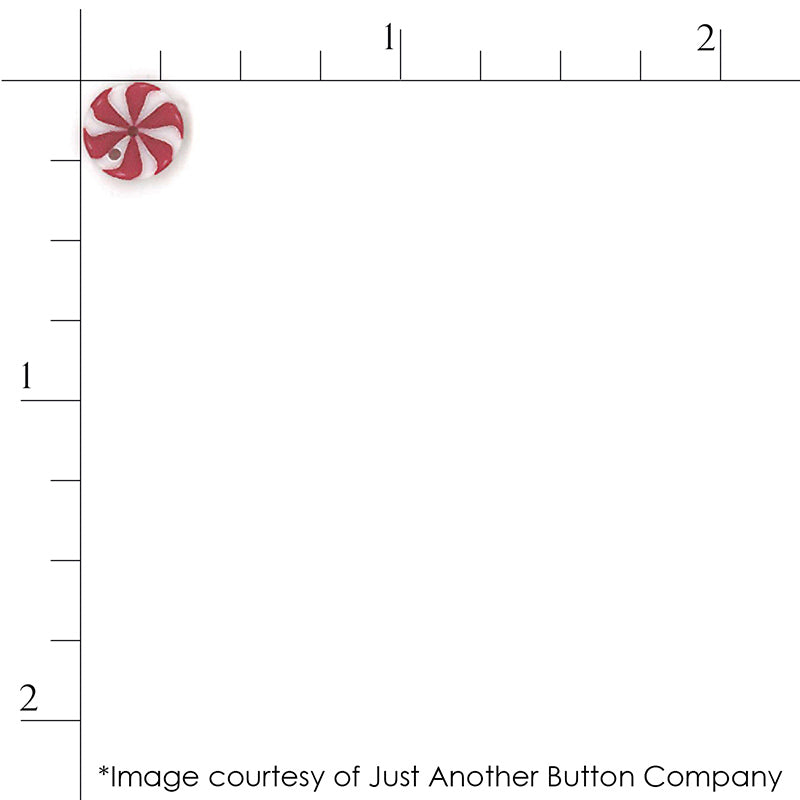 Close up scale of a red peppermint swirl candy button from Just Another Button Company