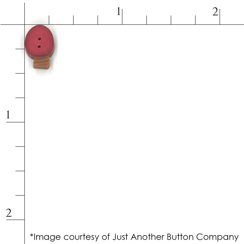 Close up scale of a red Christmas light bulb  button from Just Another Button Company
