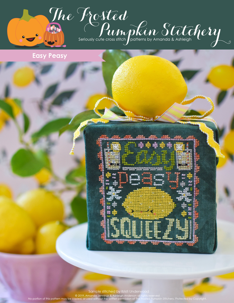 Easy Peasy Counted Cross Stitch Pattern. Image of a sour faced lemon stitched on green fabric with the text Easy Peasy above the lemon and below the word Squeezy.