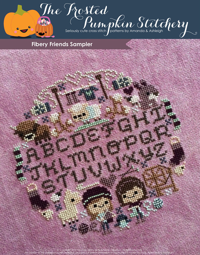Fiber-y friends counted cross stitch pattern. Traditional alphabet sampler surrounded by two friends knitting, sheep, wool, scarves, alpaca, bunnies and a yak.