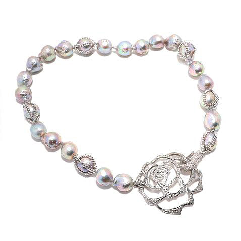 Fresh Water Pearl with pave diamond encrusted flower
