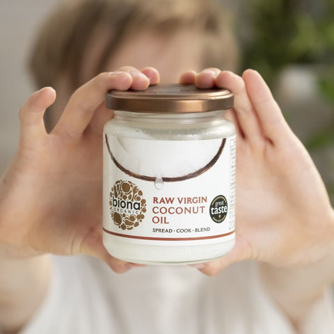 hands holding up Biona organic coconut oil