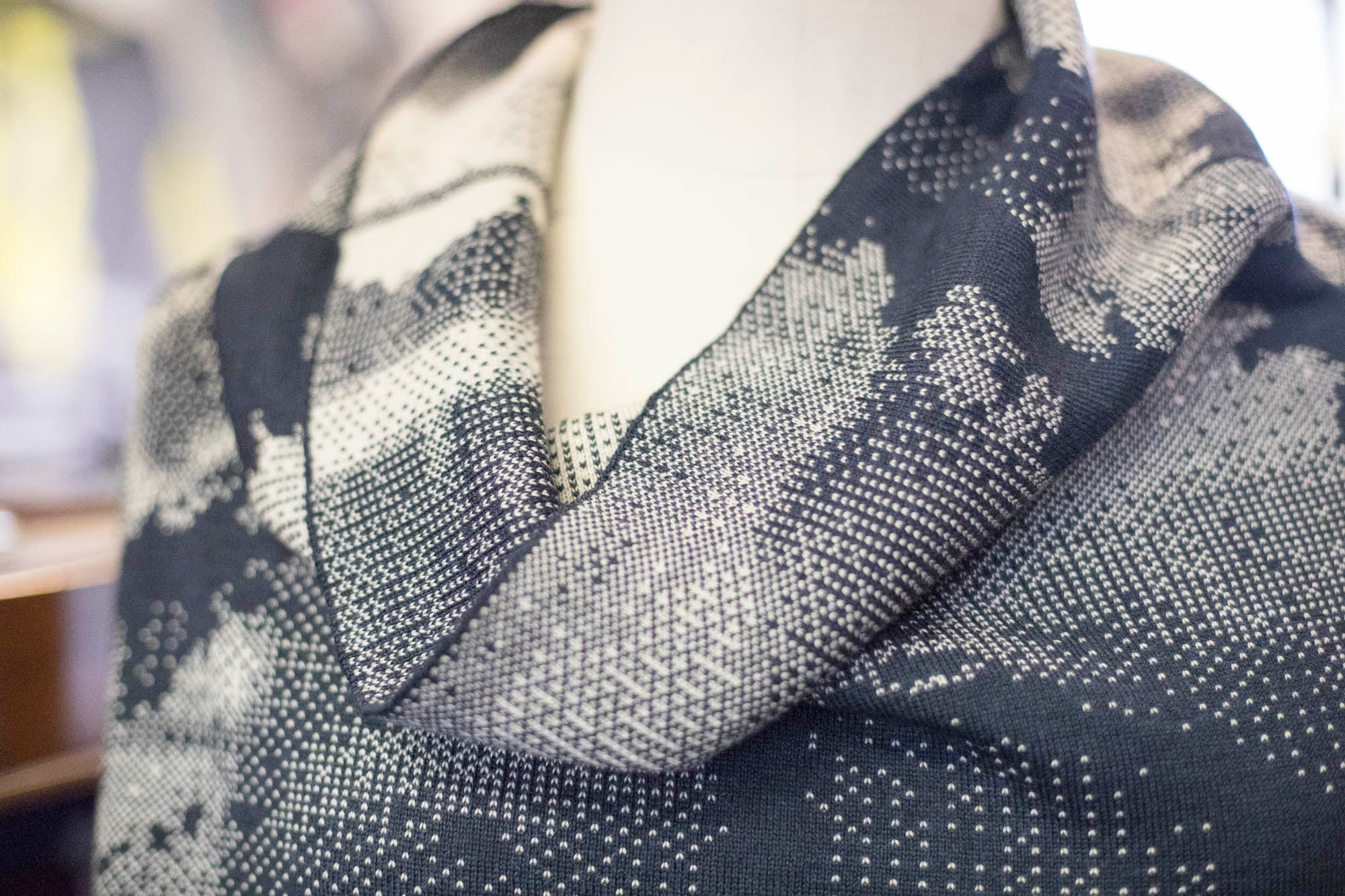 Detail of Rani jumper showing cowl neck and textile design