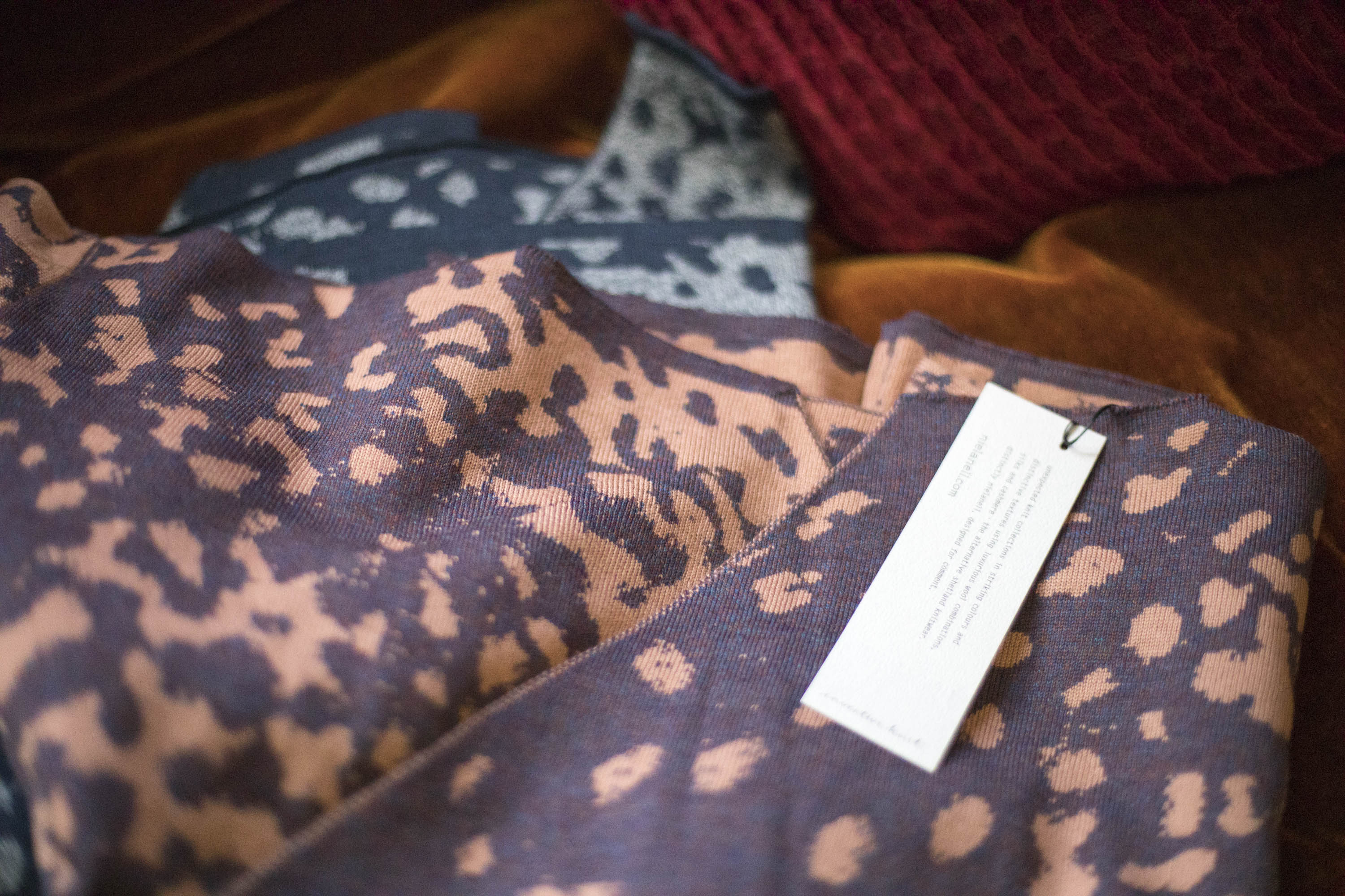 Two fine knit Marlet shawls in the Nielanell studio, Hoswick, Shetland. Abstract mottled pattern in coral and blues