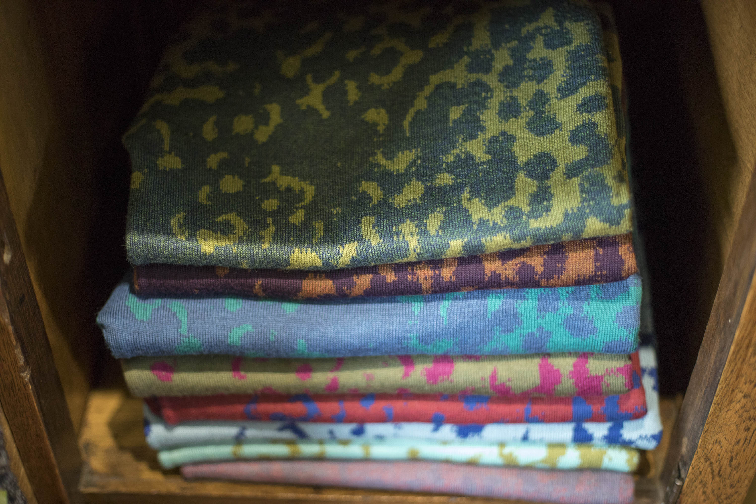 Stack of speckled, contemporary Scottish knitwear in the Nielanell studio Shetland.