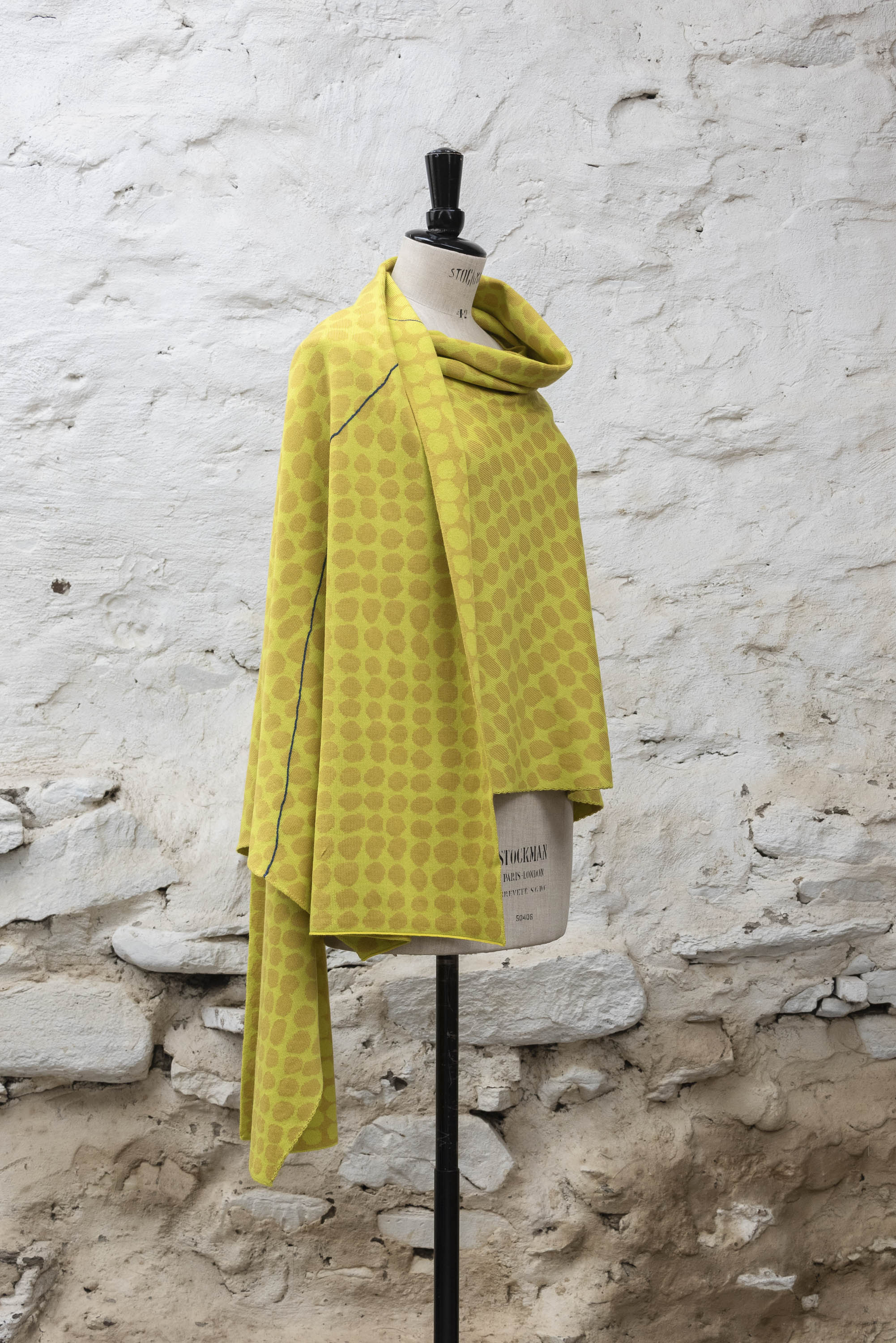 Contemporary Shetland shawl knitted in yellows with blue detail. Abstract pattern of irregular dots