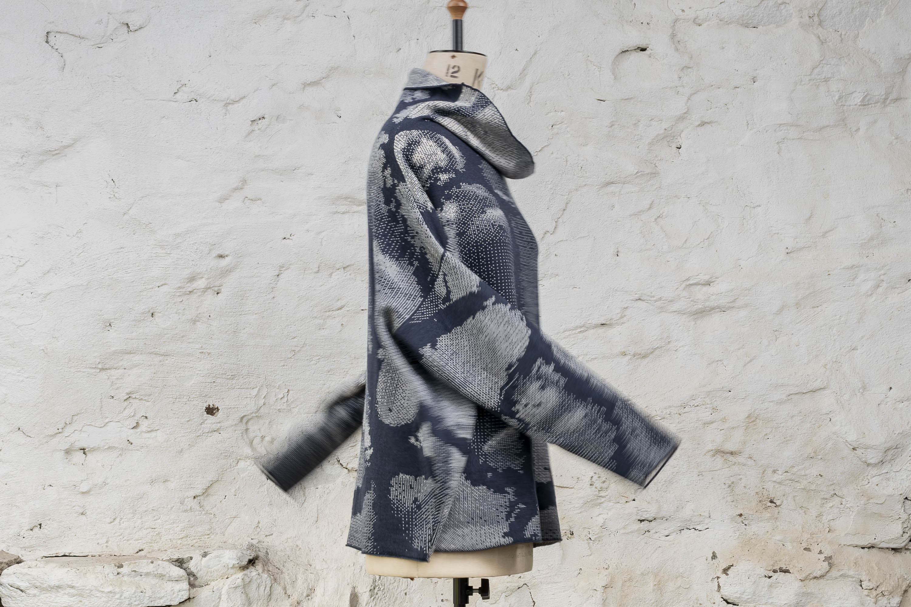 Cowl-necked contemporary and easy jumper. Inky blue and antique white with an abstract pattern