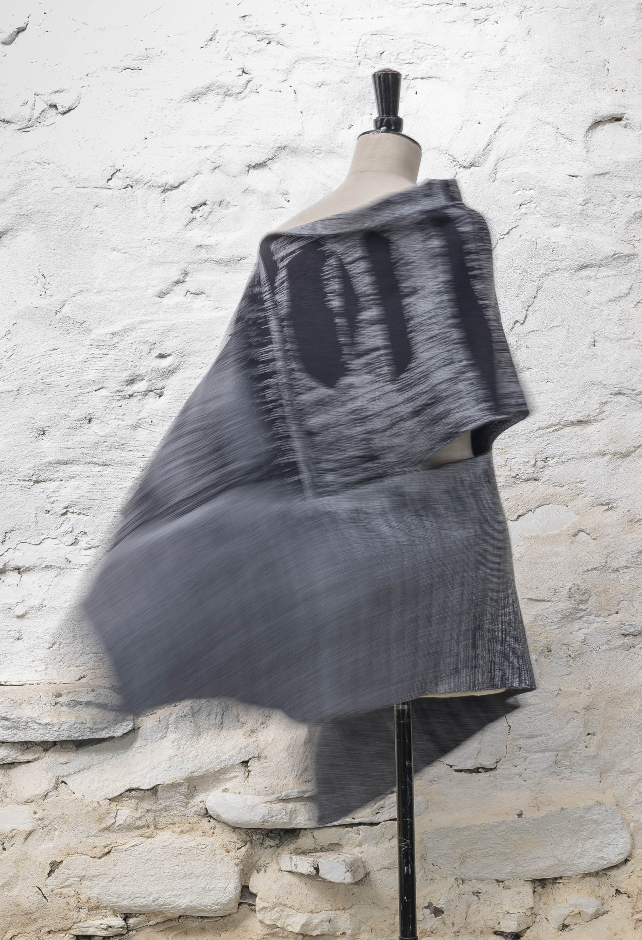 Inklines cape in greys, with abstract linear patterning