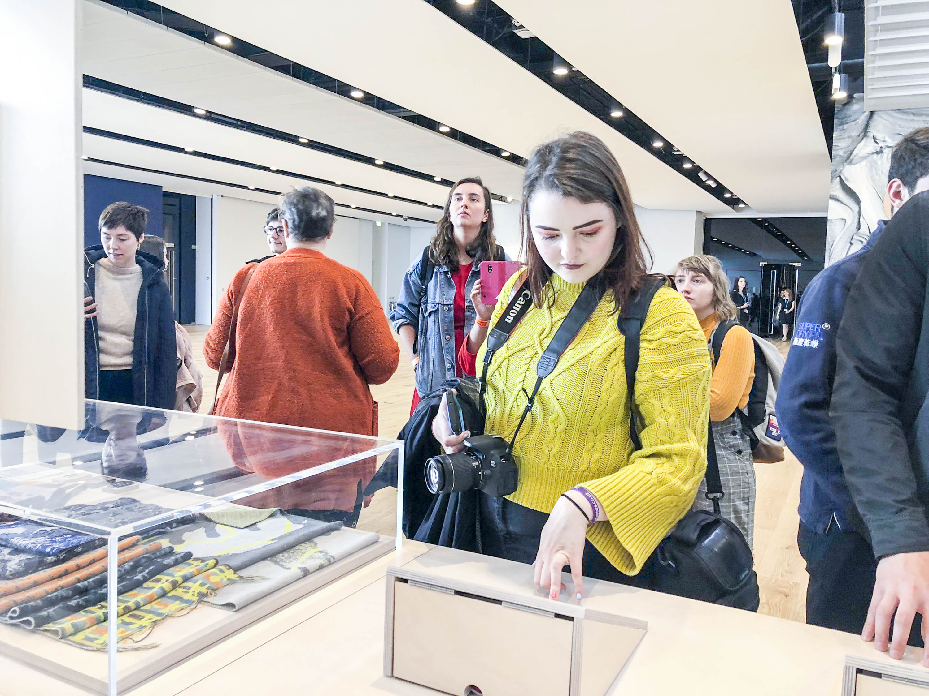 In the Michelin Galleries at V&A Dundee, visitors look at the Shetland exhibits as part of the Scottish Design Relay