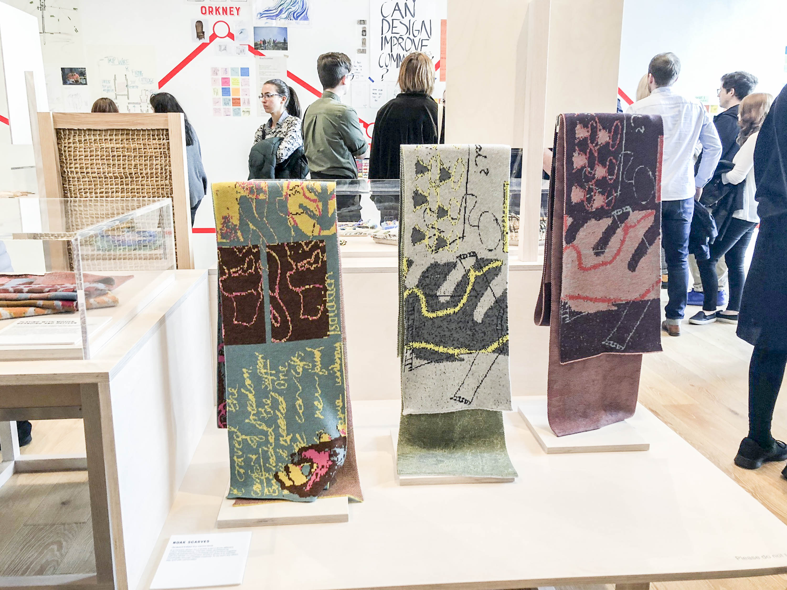 Scarves designed by the Shetland team for the Scottish Design Relay, on show at V&A Dundee at the museum's opening in September 2018. Scarves in various colours with drawn and abstract patterning.