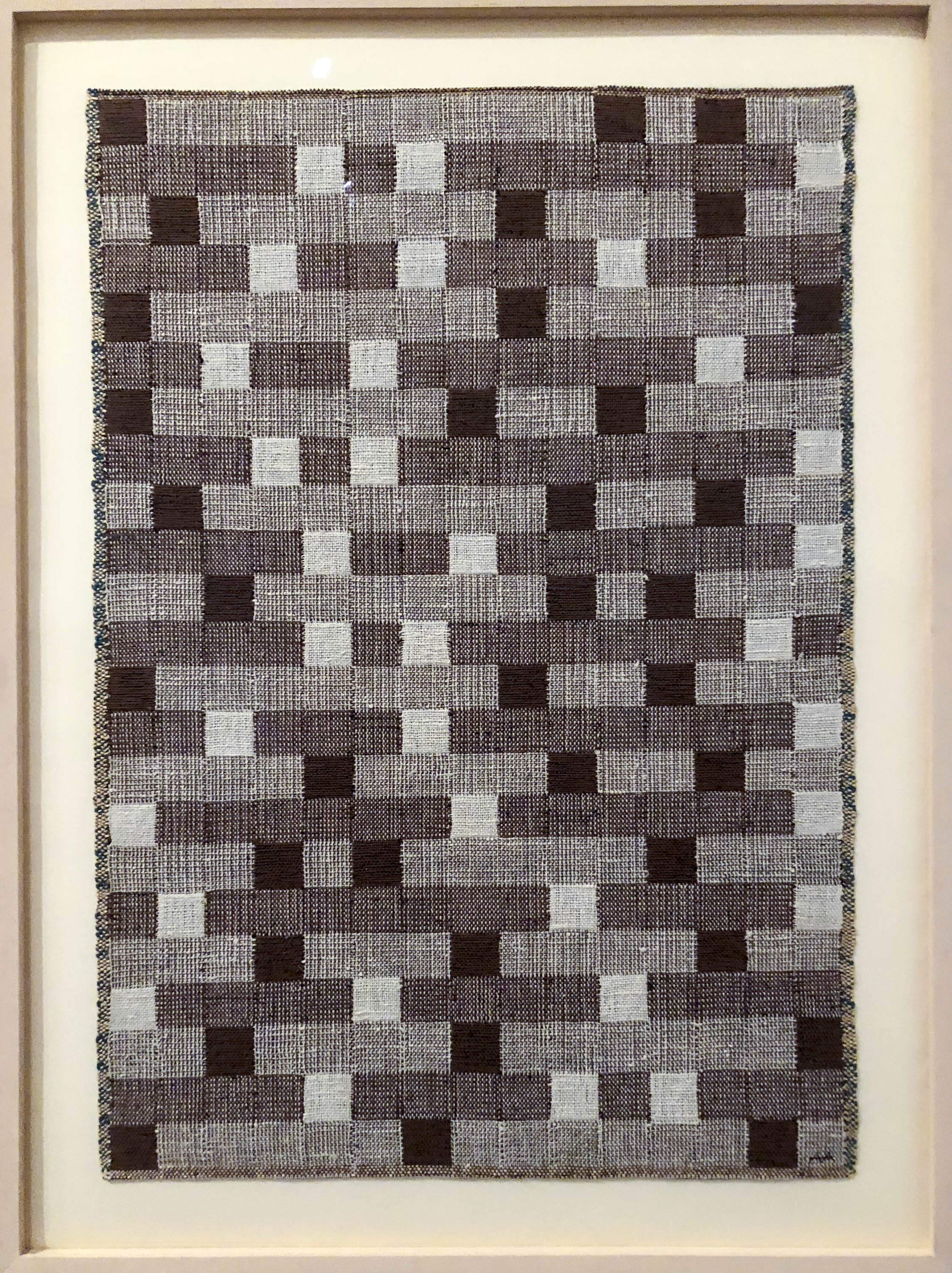 Anni Albers woven panel as seen at Tate. Black and white yarn gives linear but irregular placement of squares and rectangles