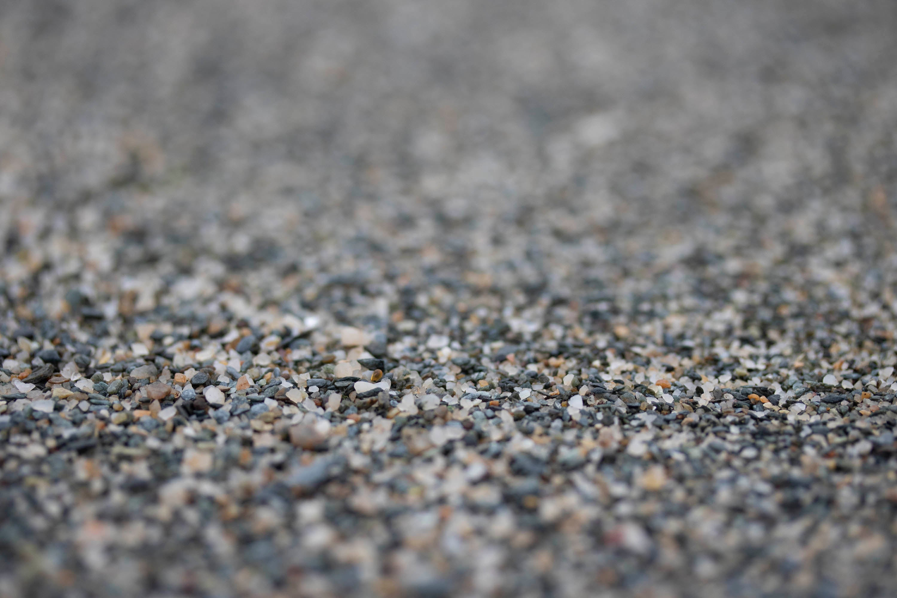 Grains of sand on the beach at Hoswick, Shetland. Large, multi-coloured grains