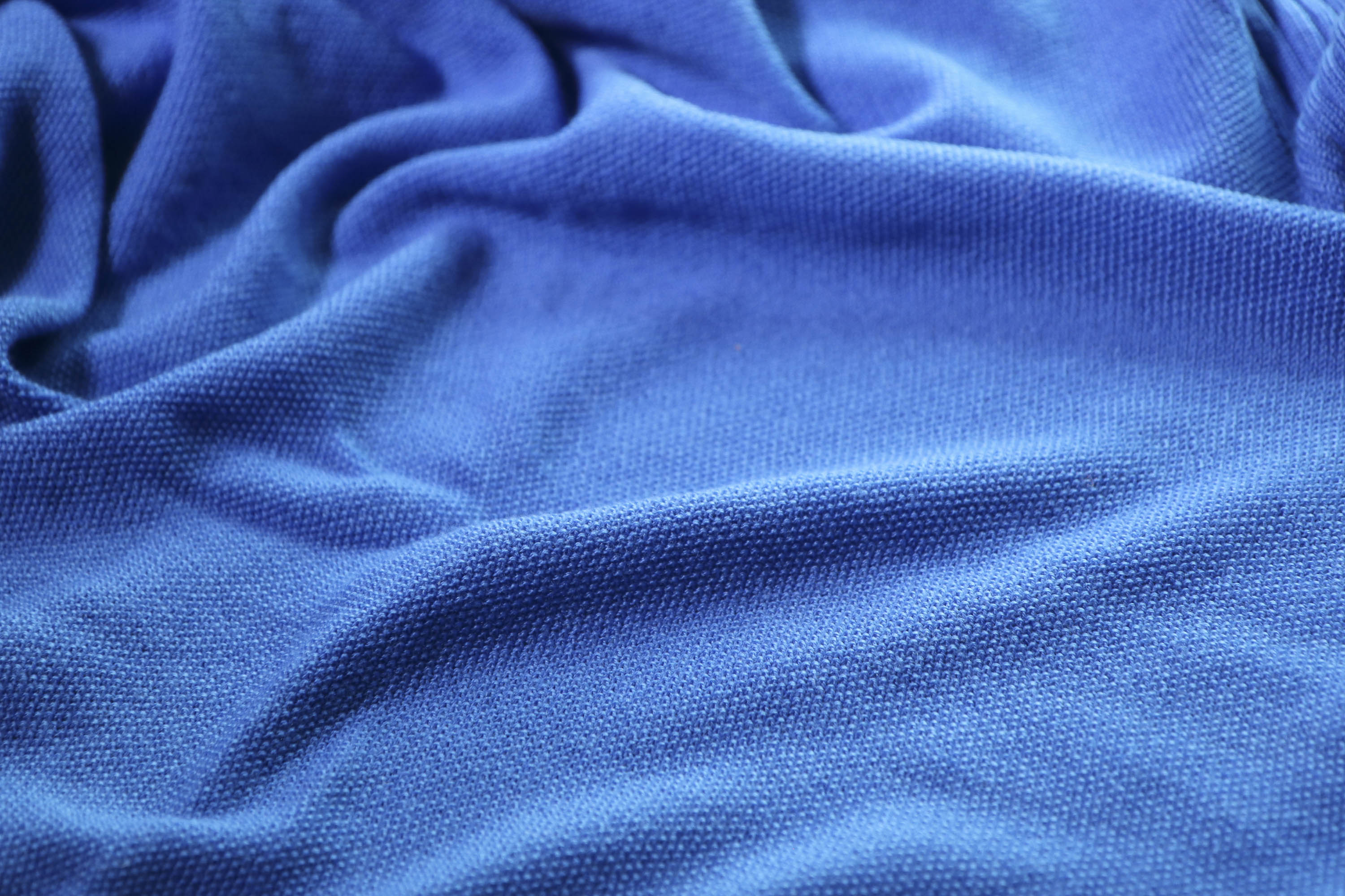 Detail of saand textile - gently textured moss stitch in bright blue yarn