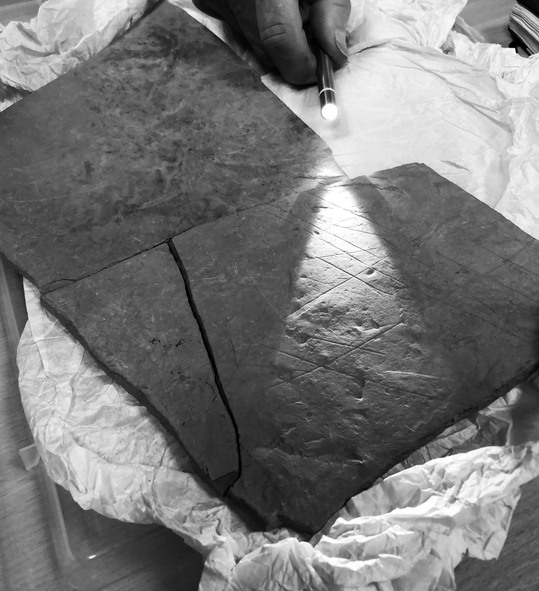 Incised stones from Ness of Brodgar - the incisions are prehistoric on these think pieces of Stone