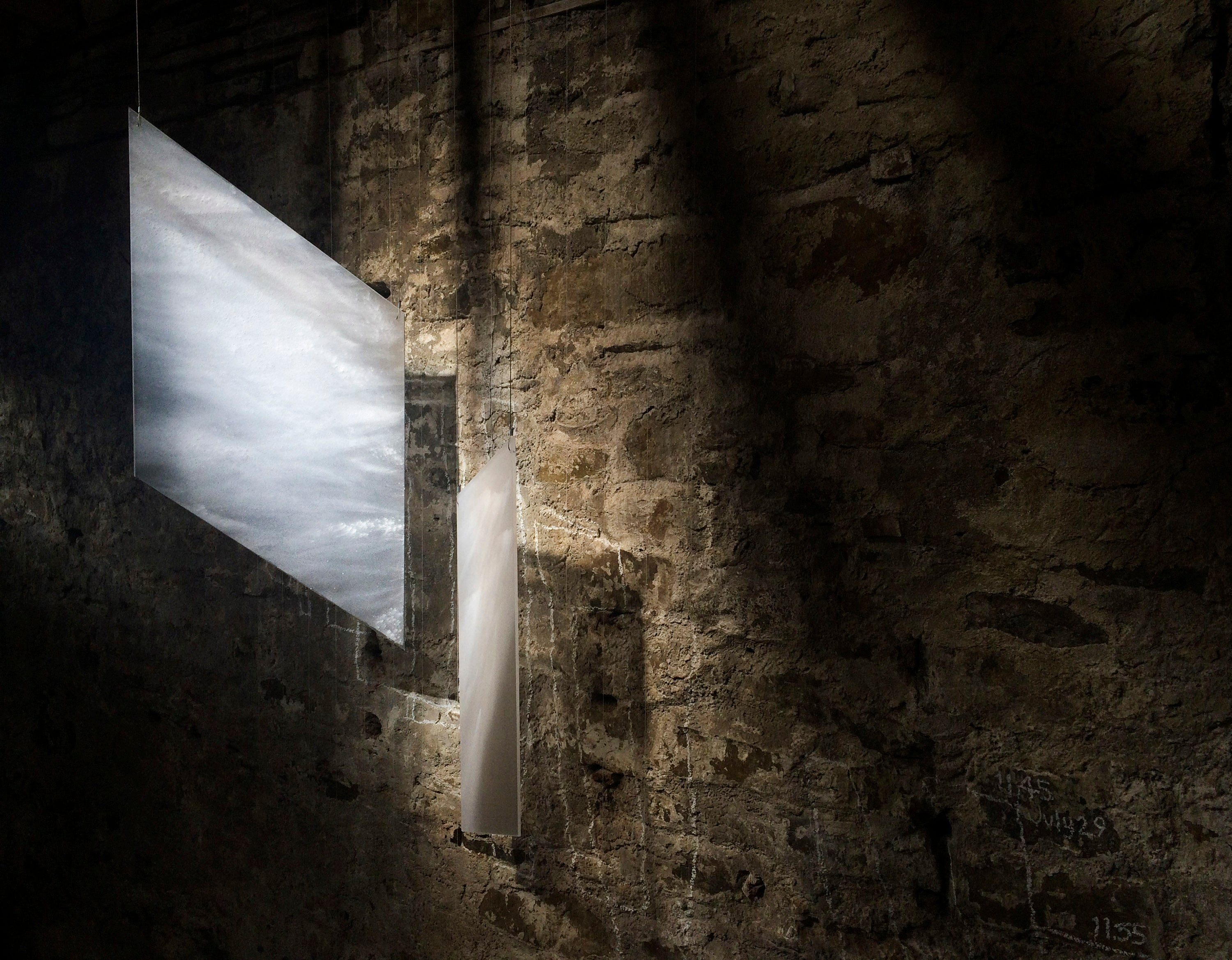 Installation in glass by Karlyn Sutherland. Glass panels made to echo shapes of light falling within the building. These exact shapes only occur once a year.