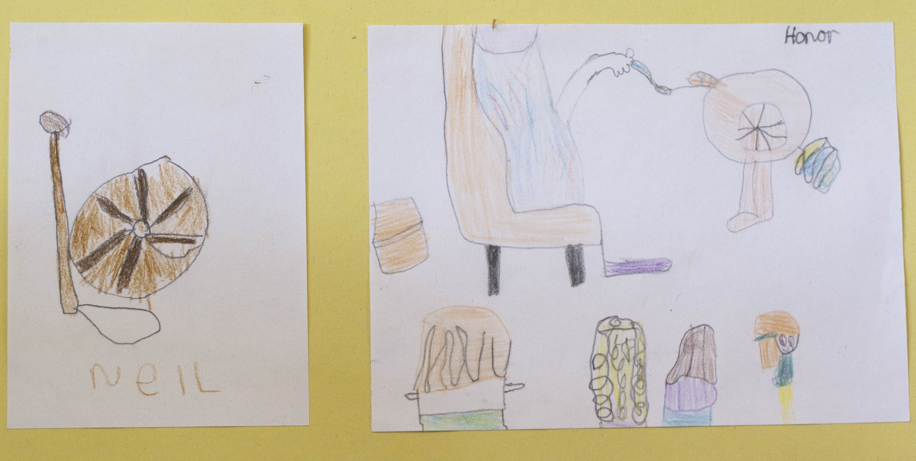 Children's drawings of a spinning wheel and a demonstration of a spinning wheel