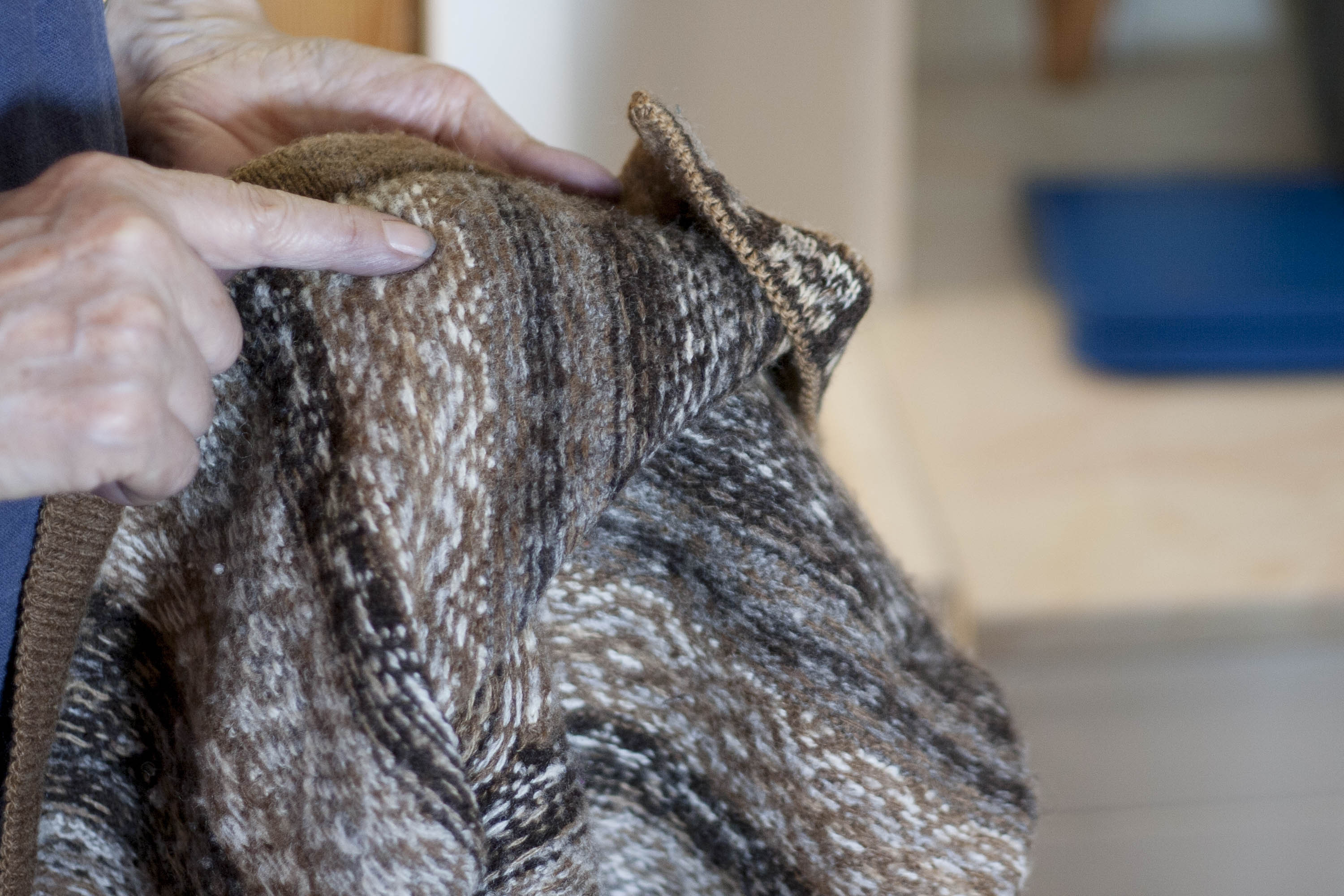Elizabeth Johnston shows the reverse of her Fair Isle cardigan, knitted with her own handspun, natural coloured Shetland yarn