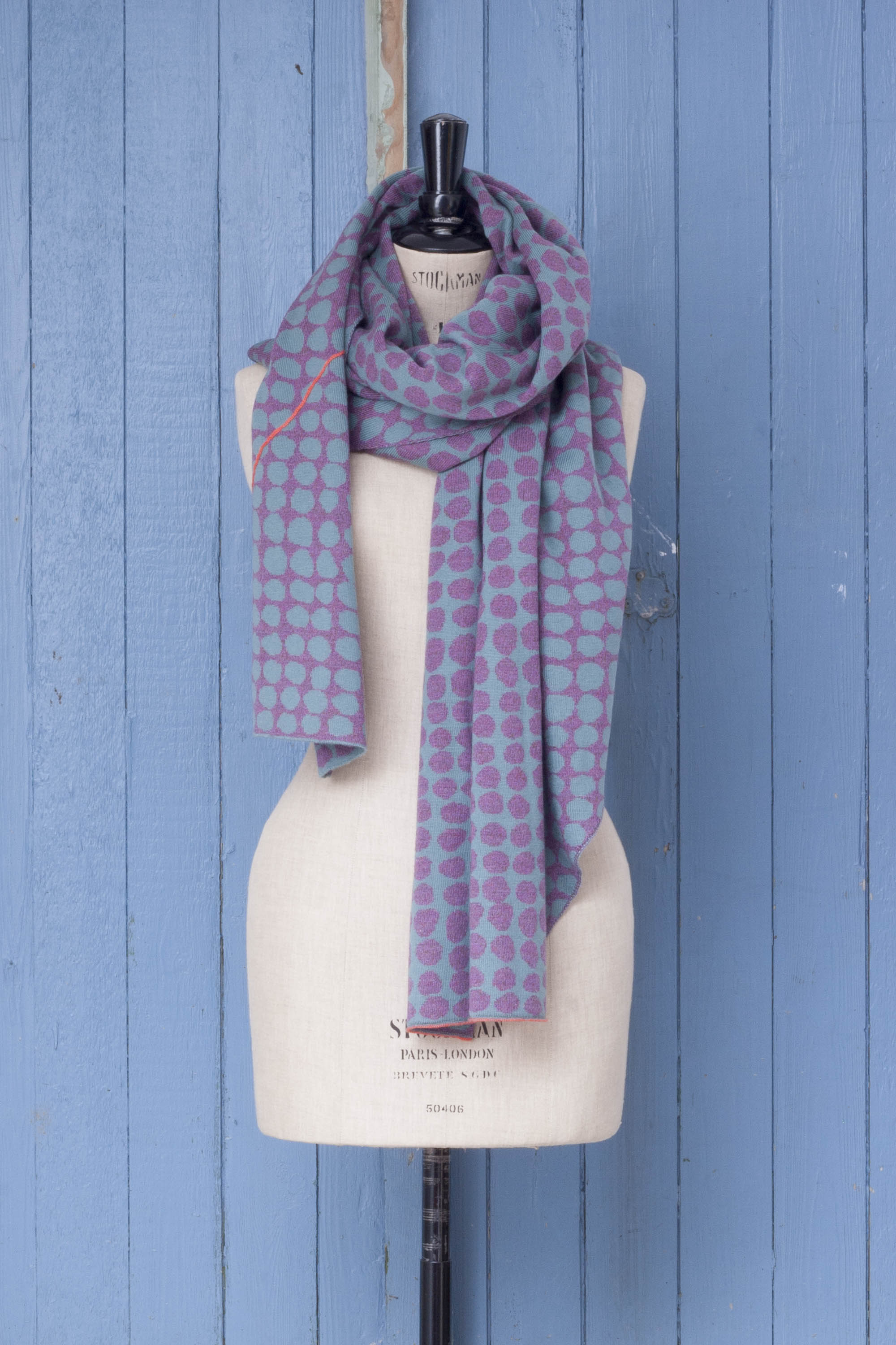 Ebb-stanes contemporary Shetland shawl made in Scotland. Pebble design in lilac and blue with hot pink individually drawn line
