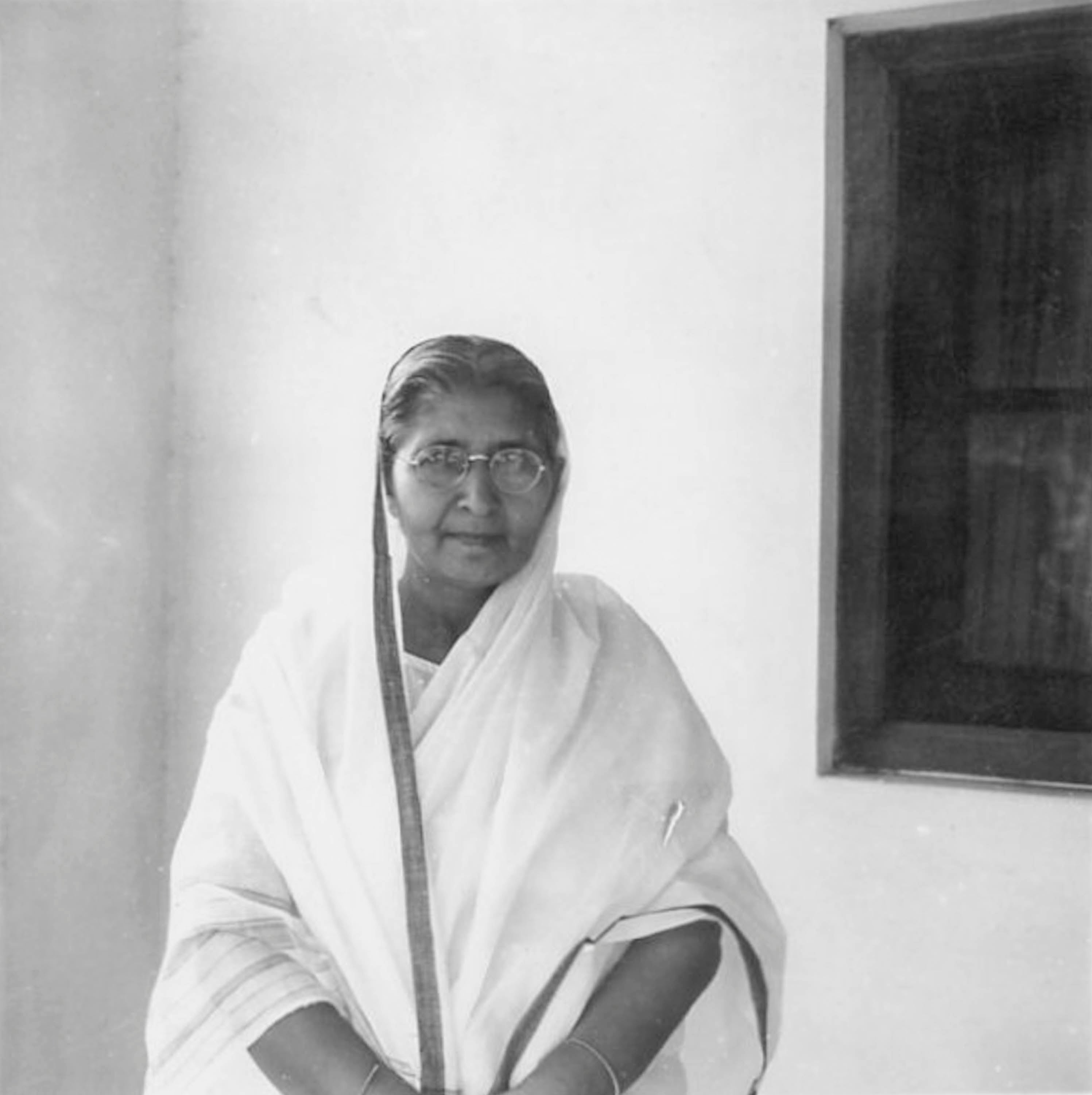 Black and white photograph of an older Indian woman