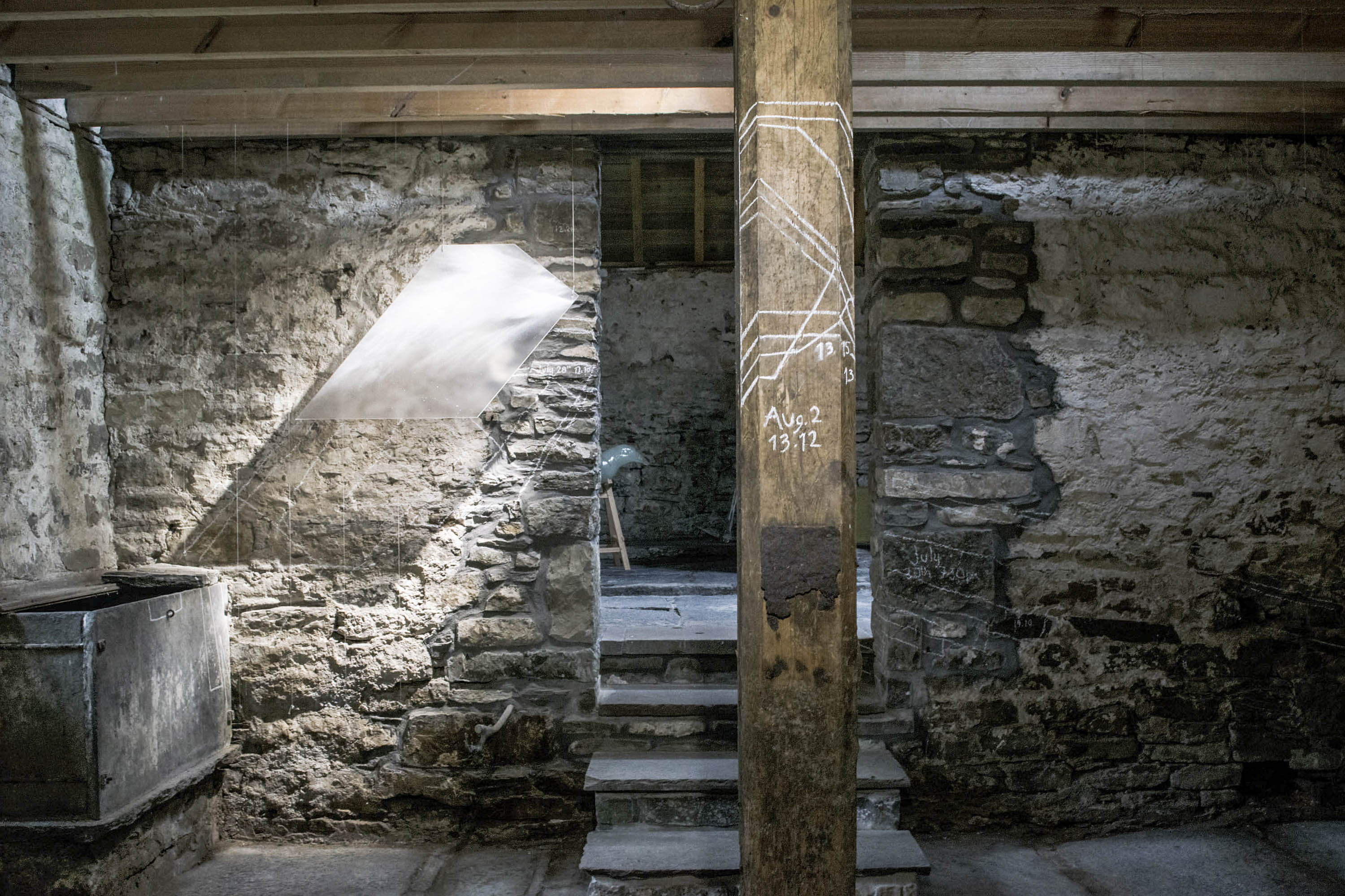 Installation by Karlyn Sutherland of glass panels tracking the shapes of light falling into the Byre at Latheronwheel, Caithness