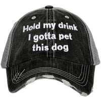 Hat { Hold my drink I gotta pet this dog } Gray with embroiderd white letters. Adjustable gray distressed trucker cap. Unisex. - Stacy's Pink Martini Boutique