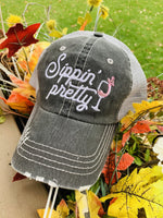 Wine hats! Sippin' Pretty • Embroidered gray trucker cap • Wine glass - Stacy's Pink Martini Boutique