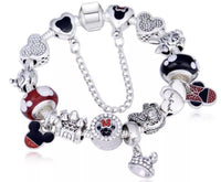 Bracelet { Mickey Mouse } Bracelet { Minney Mouse } Bow. Silver. Red. Dots. Hearts. Mickey Mouse. Glass beads. Safety chain. Assorted sizes. Search Mickey Mouse and Minnie Mouse for other items! FREE ship in USA! Pandora style. - Stacy's Pink Martini Boutique