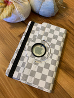 { Apple ipad mini case holder } iPad mini case holder. Plaid check designer inspired. Rotated so you can prop up for easy viewing. 7.9 inch. 3 colors! Black and white. Blue and black. Brown and black. - Stacy's Pink Martini Boutique