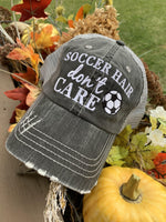 Hats { Soccer hair don't care } Gray embroidered distressed trucker cap with adjustable Velcro and hole for pony. Soccer ball. Soccer mom. - Stacy's Pink Martini Boutique