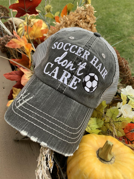 Hats { Soccer hair don't care } Gray embroidered distressed trucker cap with adjustable Velcro and hole for pony. Soccer ball. Soccer mom. -