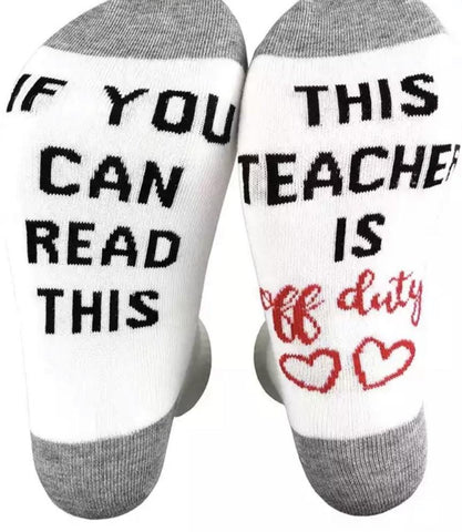 Socks { if you can read this this teacher is off duty } Gray, white with black and red graphics. Heart. NURSE or TEACHER. - Stacy's Pink Martini Boutique