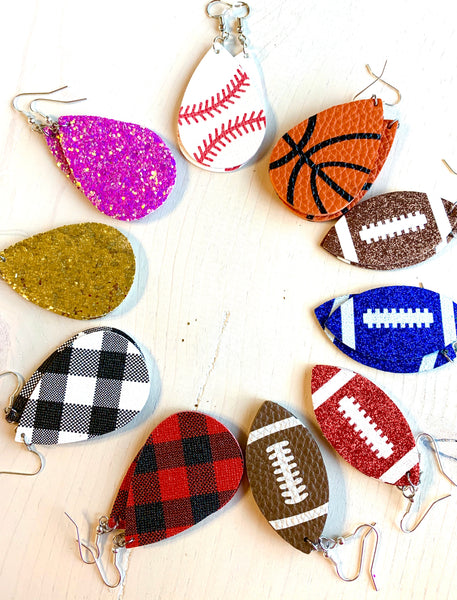Earrings { Leather } Football. Buffalo plaid. Glitter. Basketball. Baseball. Volleyball. Paisley. Floral. Leopard. Rainbow. Giraffe. $5 jewelry!