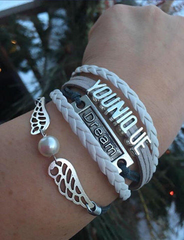 Bracelet { Younique } Wings. Dream. 1 grey/white. 1 purple/white. $5 - Stacy's Pink Martini Boutique