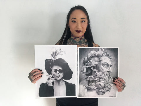 Artist Michal Overholts with her graphite drawings.