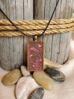Rectangular shaped pet memorial pendant/necklace inlaid with ashes, hair/fur, and dried flowers