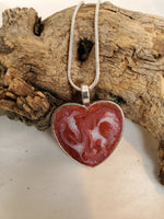Heart shaped pet memorial pendant/necklace inlaid with ashes, hair/fur, and dried flowers