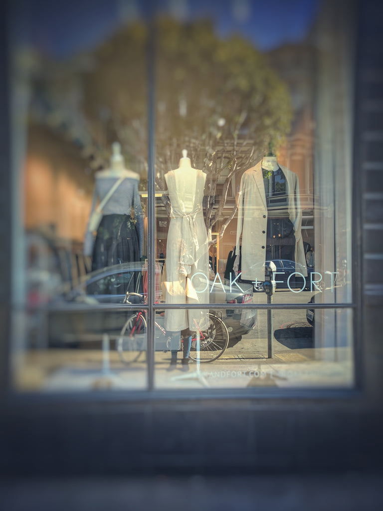 Mannequins in a clothing store window