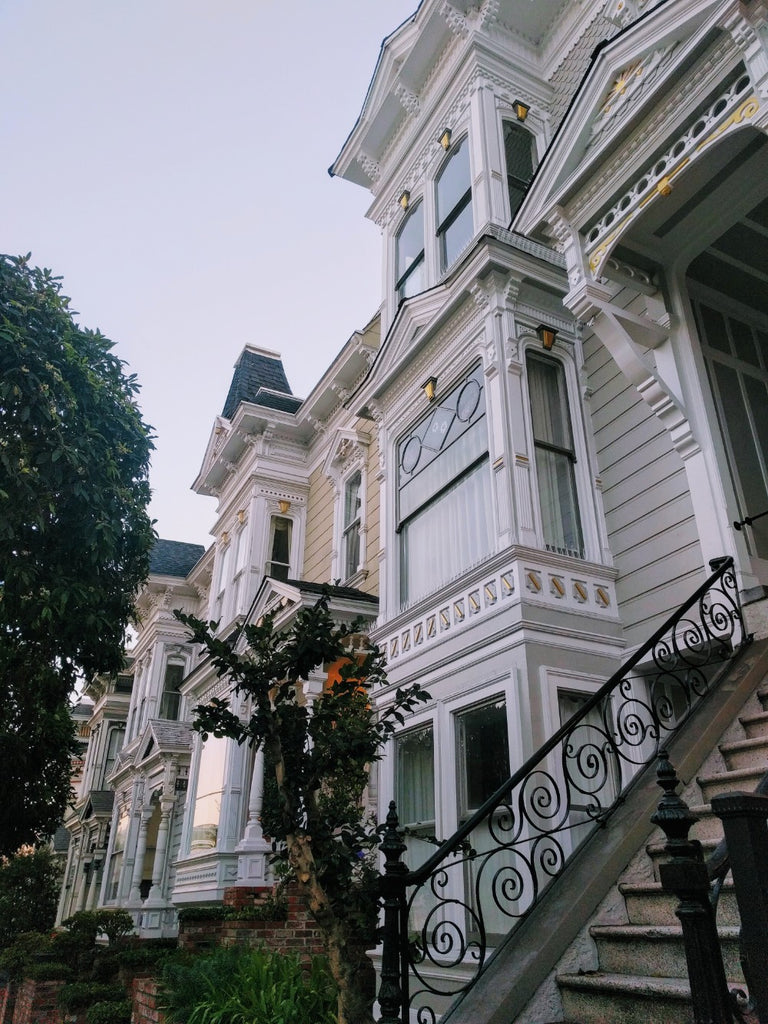 A close up view of a white Victorian home